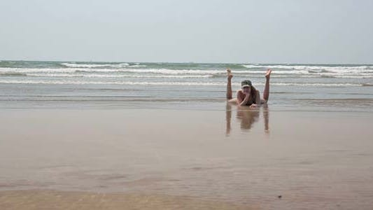 Thumbnail for Young Woman Relaxing On Sandy Beach