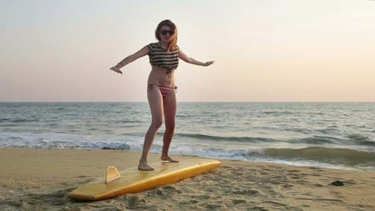 Thumbnail for Woman Balancing On Surfboard