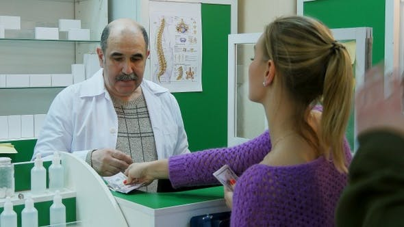 Thumbnail for Senior Pharmacist Assisting a Female Customer at The Head