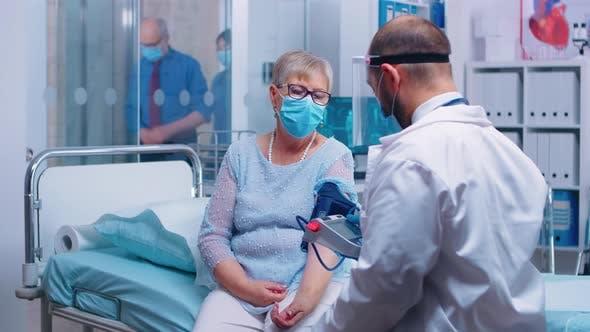 Measuring Old Retired Lady Blood Pressure