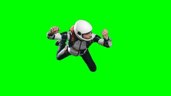 Calm Skydiver in Free Fall Looking at Altimeter