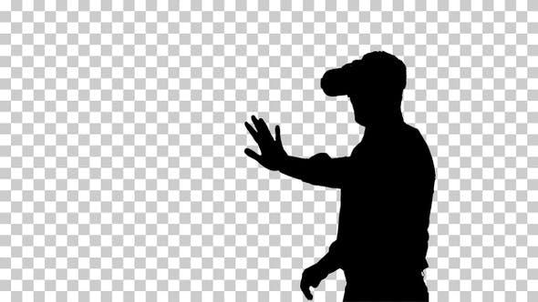 Silhouette Businessman in virtual reality headset walking