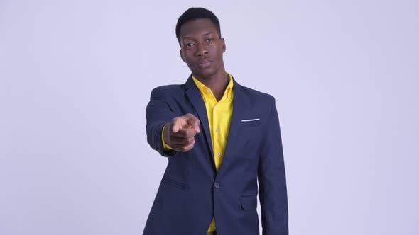 Young Happy African Businessman in Suit Pointing at Camera