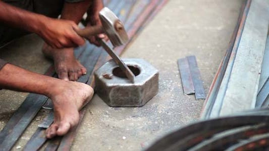 Thumbnail for Local Craftsman Working On Piece Of Metal, India