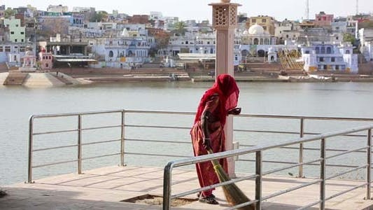 Thumbnail for Woman Swiping Jetty, Pushkar Cityscape