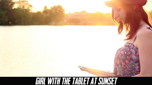 Thumbnail for Girl With The Tablet At Sunset 2