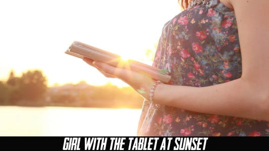 Thumbnail for Girl With The Tablet At Sunset 4