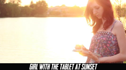 Thumbnail for Girl With The Tablet At Sunset 5