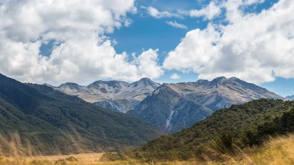 Clouds over Alpine Mountains Landscape in Wild Nature of New Zealand