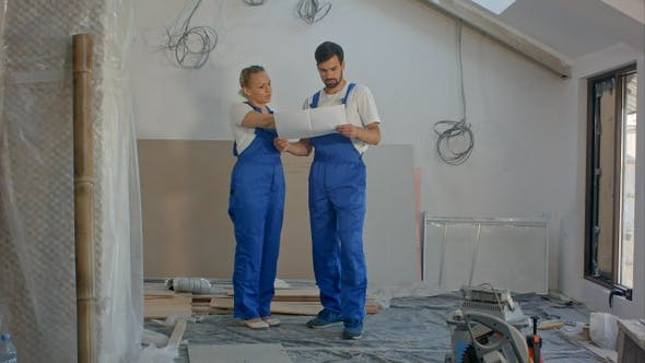 Thumbnail for Architects working team holding a blueprints in house