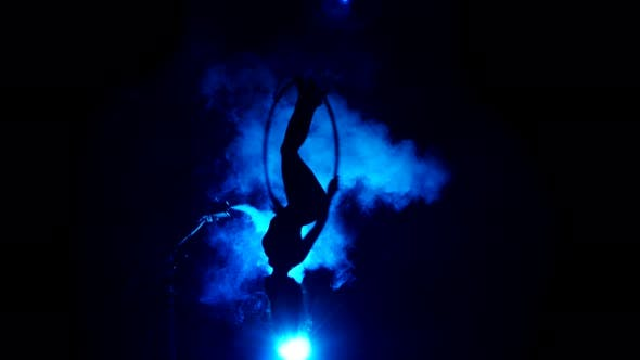 Thumbnail for Aerial Acrobat Woman on Circus Stage. Silhouette on a Blue Background.