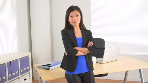 Thumbnail for Confident Chinese businesswoman standing in office