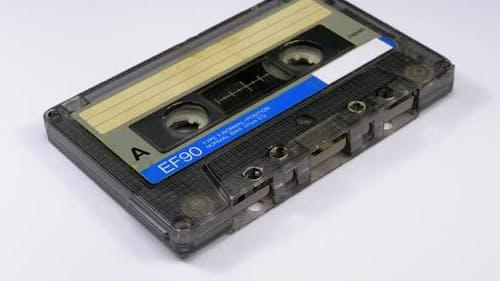 Vintage Audio Cassette Rotates on White Background