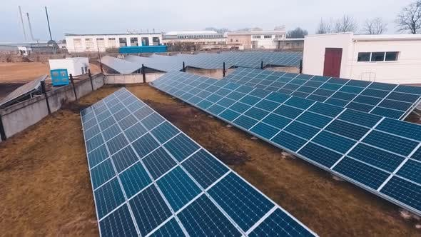 Thumbnail for Flying over the blue sunny batteries on the modern solar power plant