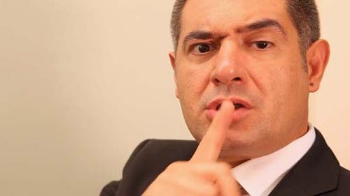 Businessman With Finger On Lips
