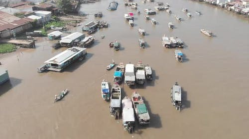 Aerial: flying over Cai Rang floating market Can Tho,  Vietnam