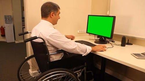 Businessman With Wheelchair
