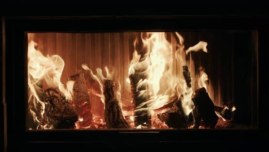 Firewood is Burning in a Modern Stylish Fireplace