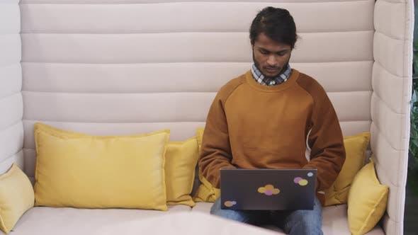 Indian Businessman Working on Laptop
