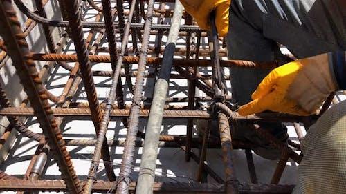Hands of Builder on Reinforcement Works