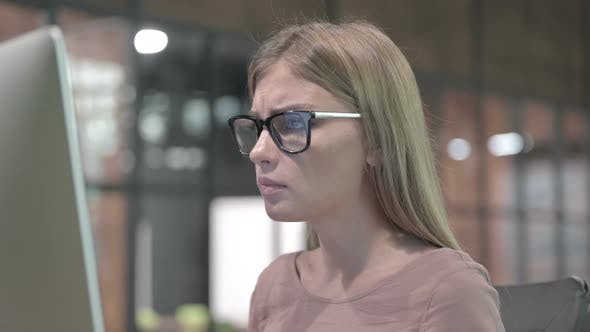 Thumbnail for Portrait Shoot of Ambitious Woman Getting Upset on Computer