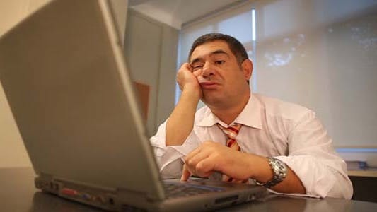Thumbnail for Tired Businessman Using Laptop In Office