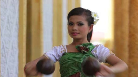 Thumbnail for Beautiful Asian Girl Performs Coconut Folk Dance