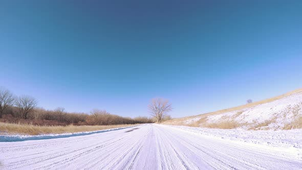 Thumbnail for Driving through winter landscape in Cherry Creek State Park, Colorado.