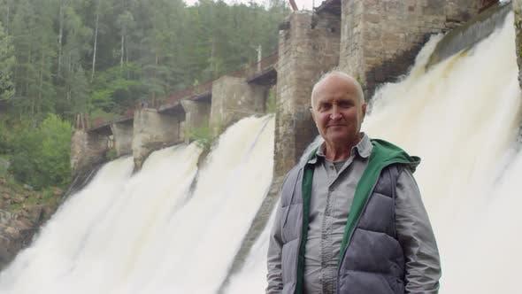 Thumbnail for Senior Man Posing in front of Dam Spillway