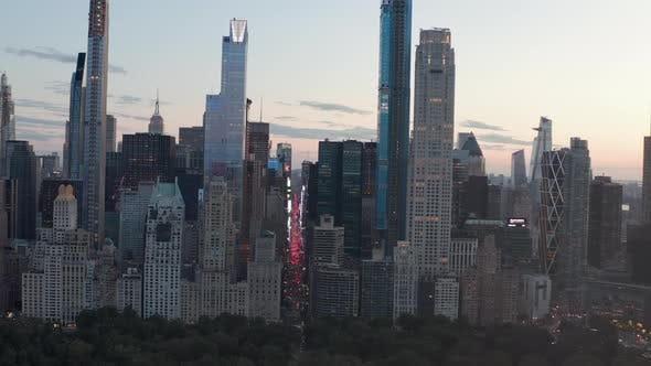 Thumbnail for View of 7Th Avenue Traffic and Times Square Over New York City Central Park at Sunset with