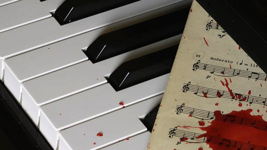 Thumbnail for Piano and Blood Drops on Music Sheet