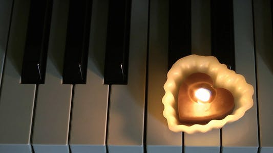 Heart Shape Candle on the Piano