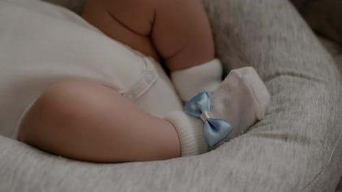 Tiny Newborn sleeping Baby's feet. Happy Family concept, selective soft focus.