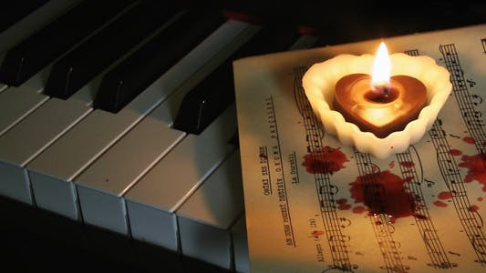 Thumbnail for Piano Candle and Blood Drops on Music Sheet