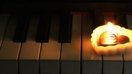 Heart Shape Candle on the Piano 2
