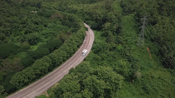 Thumbnail for Aerial View Of Countryside Road Passing Through The Mountain Landscape 01