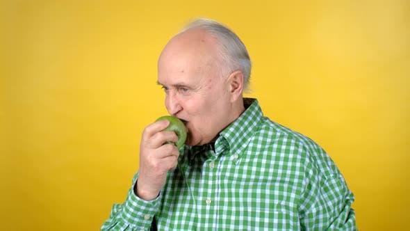 Cover Image for Portrait of Elderly Man Eating Apple