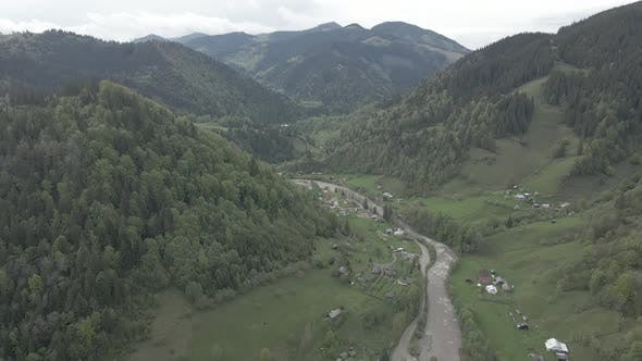 Thumbnail for Ukraine, Carpathian Mountains: River in the Mountains. Aerial. Gray, Flat