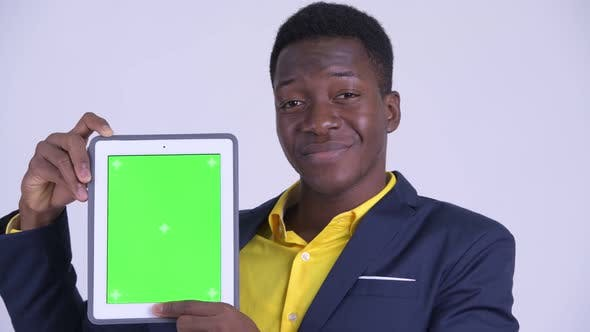 Thumbnail for Face of Young Happy African Businessman Showing Digital Tablet