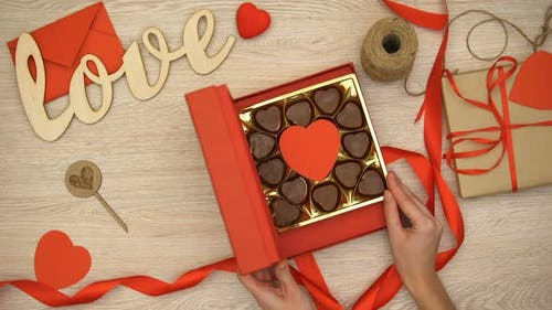 Lady Opening Valentines Giftbox With Heart-Shaped Chocolate Candies, Aphrodisiac