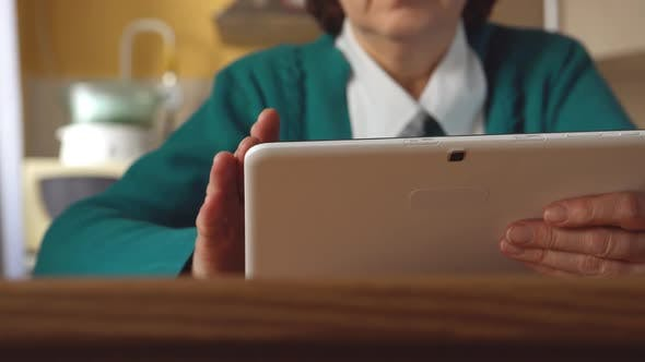 Thumbnail for White Tablet Pc In A Mature Woman Hands