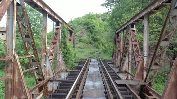 Thumbnail for Flying backwards over the railway bridge 4K drone video
