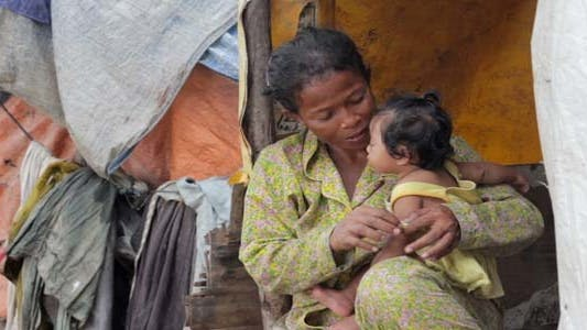 Thumbnail for Mother Feeding Baby In Cambodian Slums