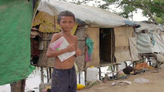 Thumbnail for Boy In Slum Holding Book Want To Go School