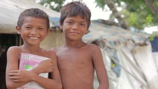 Thumbnail for Cambodian Boys In Slum, Shacks in Background
