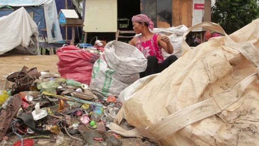 Thumbnail for Garbage Gatherers Assorting Trashes In Slums