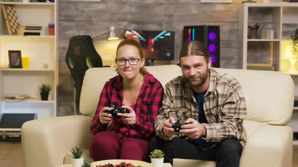 Thumbnail for Excited Couple Giving High Five While Playing Online Video Games