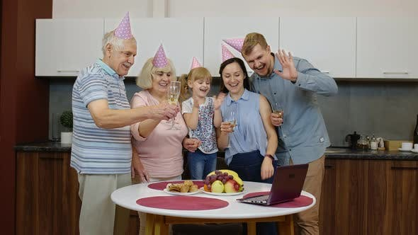 Thumbnail for Happy Family Making Birthday Surprise Sending Congratulations Online with Laptop During Coronavirus