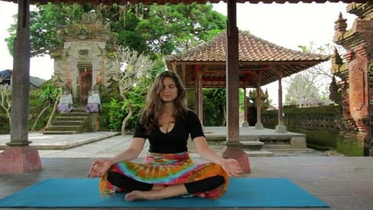 Thumbnail for Caucasian Woman Meditating Yoga In Balinese Temple