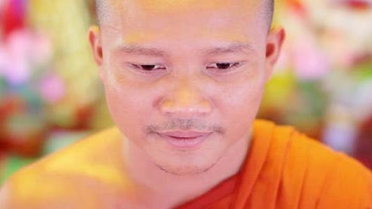 Thumbnail for Buddhist Monk With Orange Robe Pray in Temple